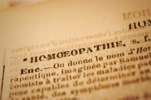 Close up of the word HOMEOPATHIE in an old French dictionary. Selective focus and Canon EOS 5D Mark II with MP-E 65mm macro lens.